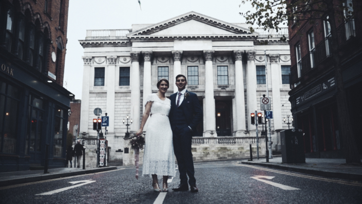 wedding photo with city hall in background