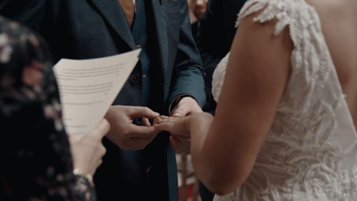 Daniel is putting wedding ring on Alison finger.