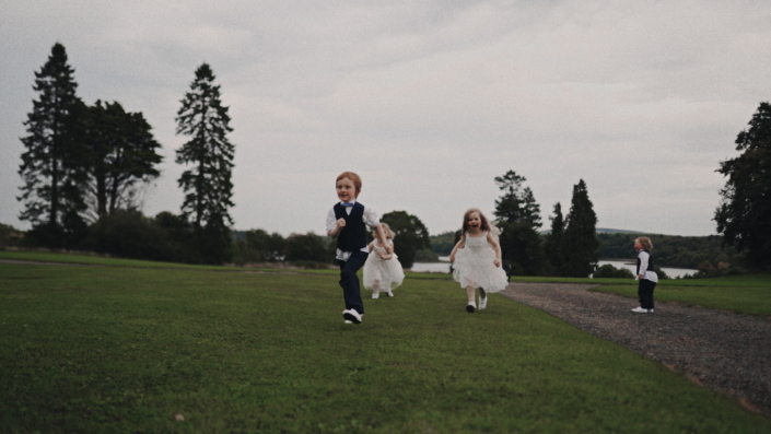 Page boy and flower girls running happily.