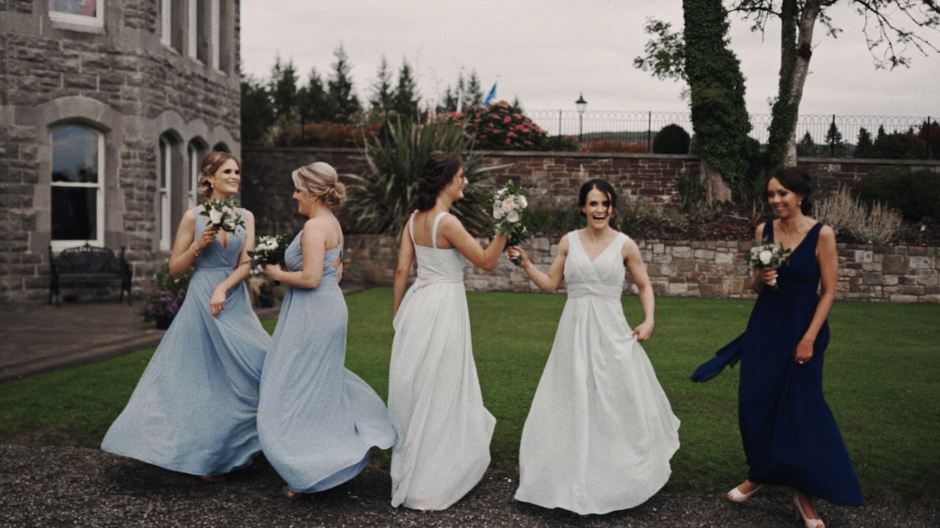 Bridesmaids are presenting their dresses.