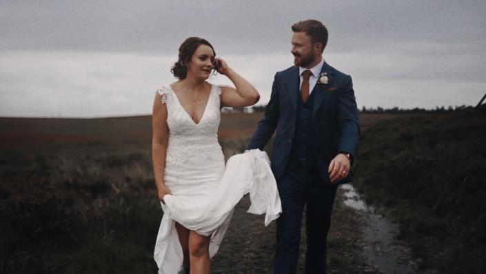 Bride wit groom walking.