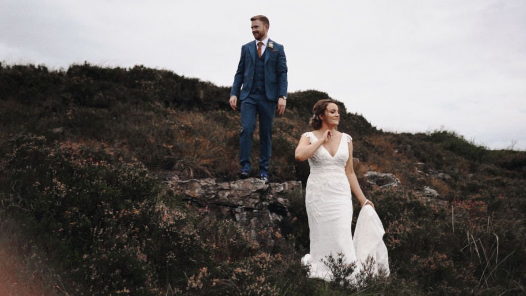 Bride and Groom posing to picture on Irish nature