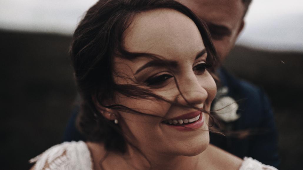 Alison wedding bride is smiling.