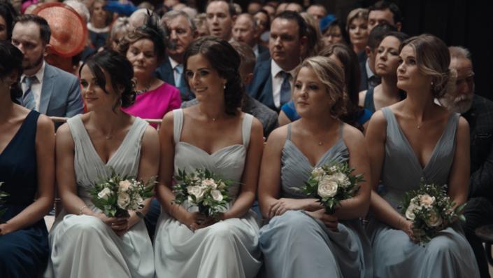 Bridesmaids during ceremony.