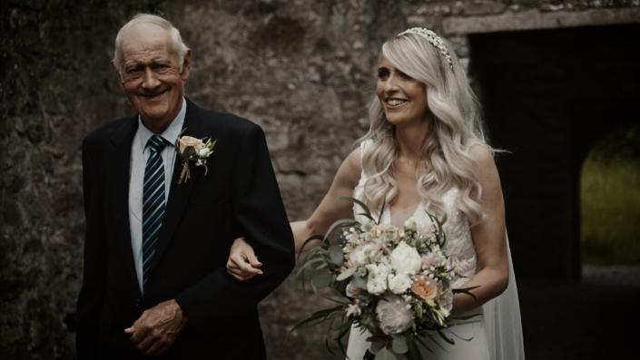 Finola with father walk down aisle