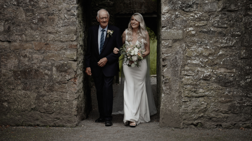 bride with father enter ceremony