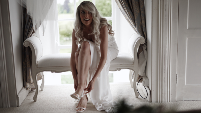 bride is pitting shoes