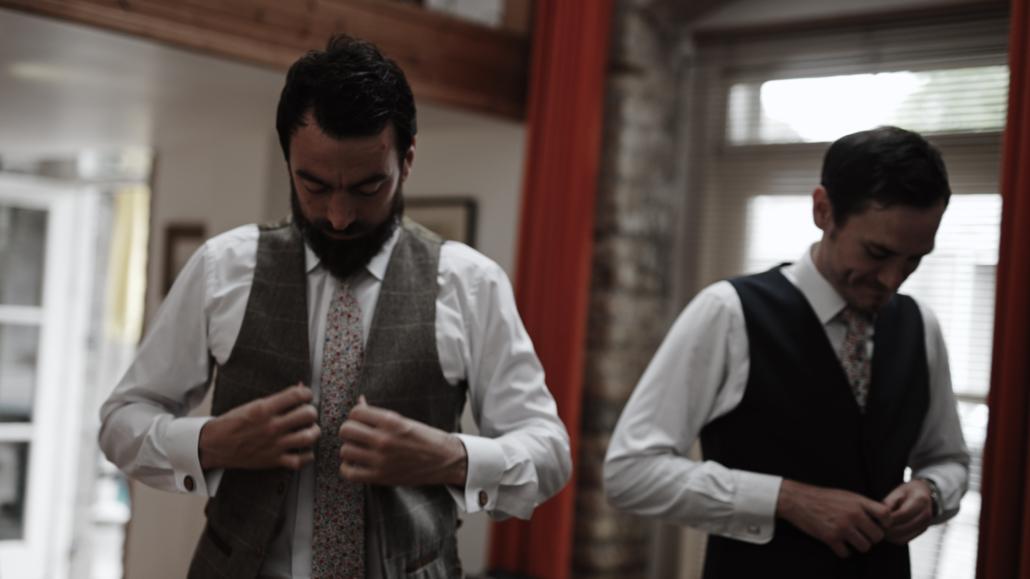 putting wedding vest