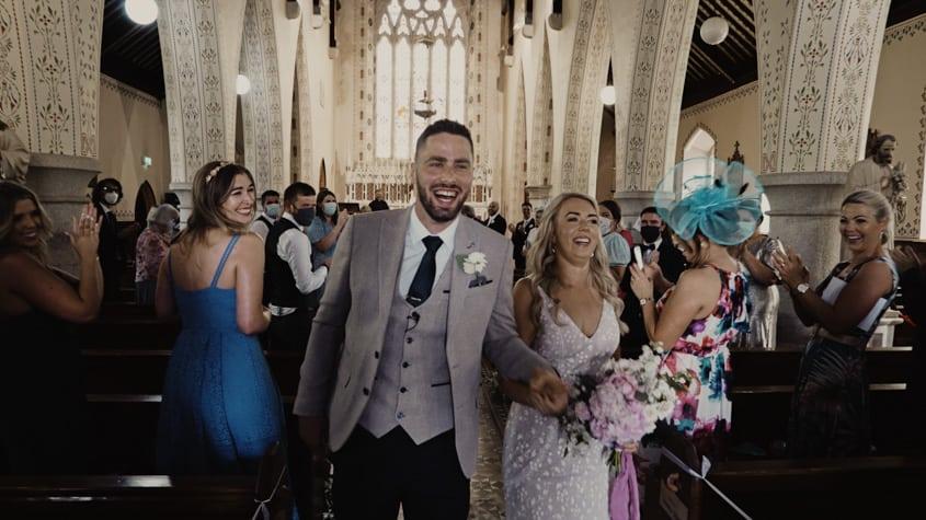 happy couple leaving church