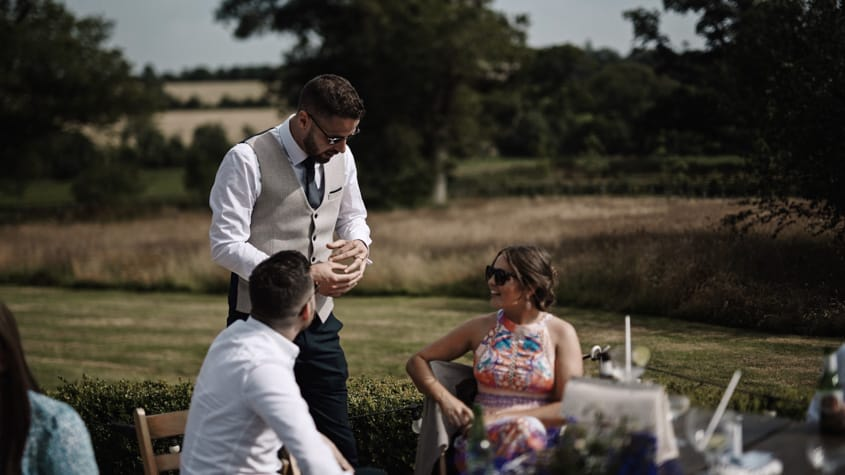 groom showing wedding ring
