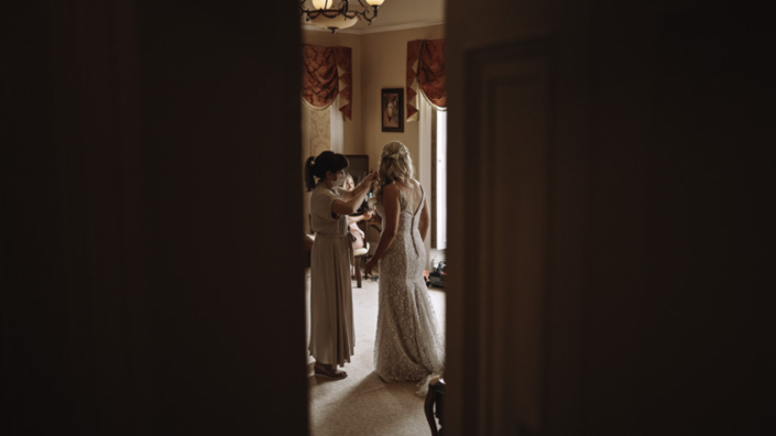 Bride is putting the dress